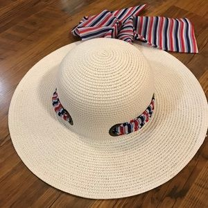 Women's white straw hat with red & blue ribbon